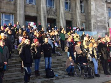 Photograph of a Leeds staff/student solidarity demo. People line the steps with placards.