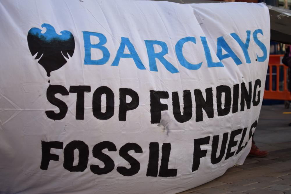 Banner reads: Barclays stop funding fossil fuels