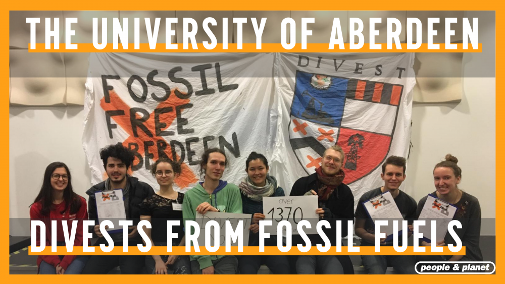 """Image of the Fossil Free Aberdeen group holding a banner reading """"Fossil Free Aberdeen"""" with victory text overlaid reading: the University of Aberdeen divests from fossil fuels"""