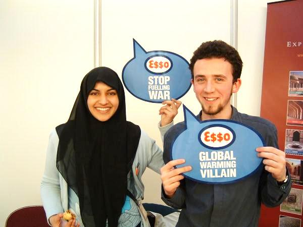 Students hold up Stop ESSO speech bubbles